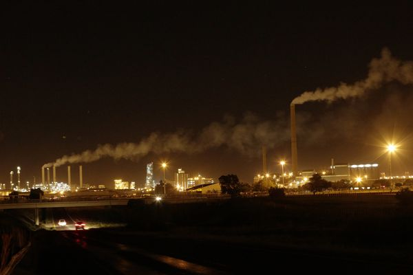 A night view of Sasol Plant, a plant that produces petrol and diesel from coal, in Sasolburg, South Africa, Tuesday, Dec. 4, 2018. The two-week U.N. climate meeting in Poland is intended to finalize details of the 2015 Paris accord on keeping average global temperature increases well below 2 degrees Celsius (3.6 Fahrenheit). (AP Photo/Themba Hadebe)