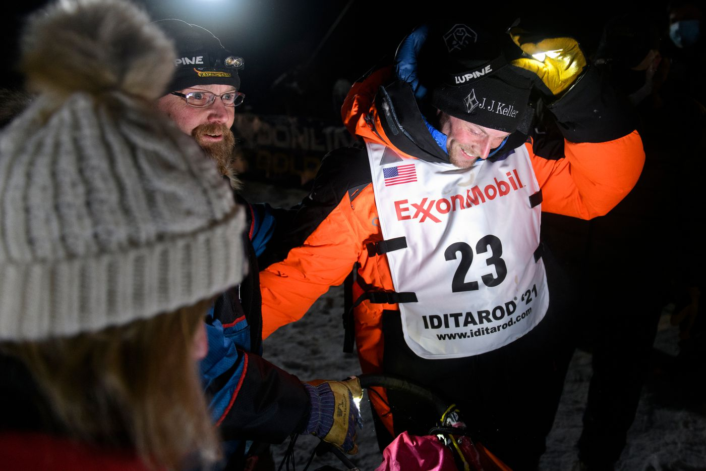 Dallas Seavey, right, is greeted by his parents Janine and Mitch Seavey after he arrived in Willow to win the 2021 Iditarod early Monday morning. (Marc Lester / ADN)