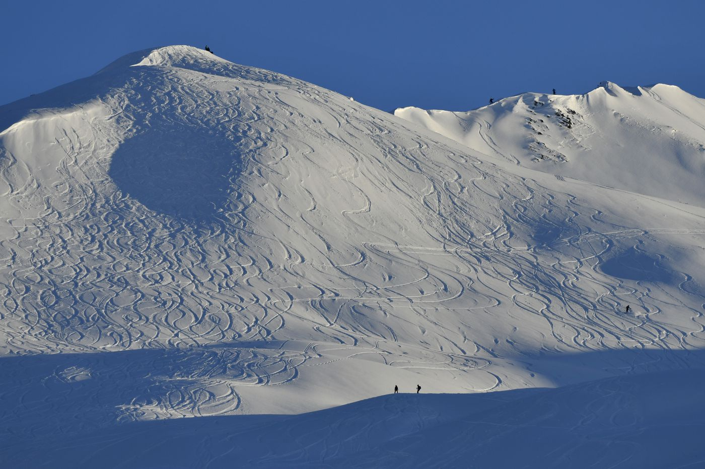 Lines from backcountry skiers leave patterns in slopes along the Tincan Peak ridge line on December 31, 2020. (Marc Lester / ADN)
