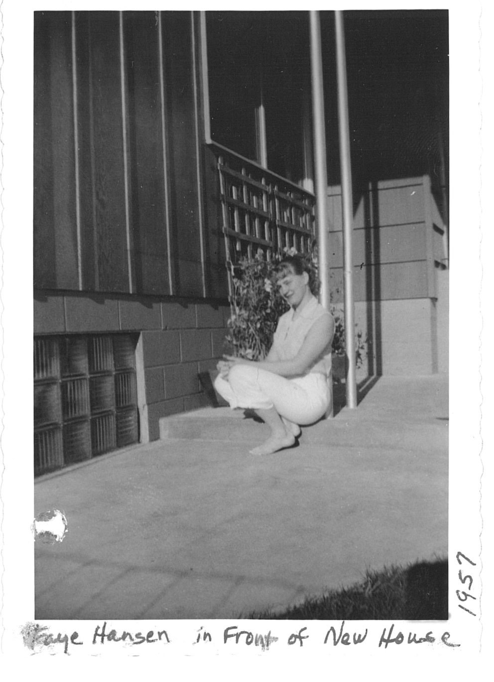Faye Hansen as a young woman outside her childhood home. (Courtesy Faye Hansen Robb)