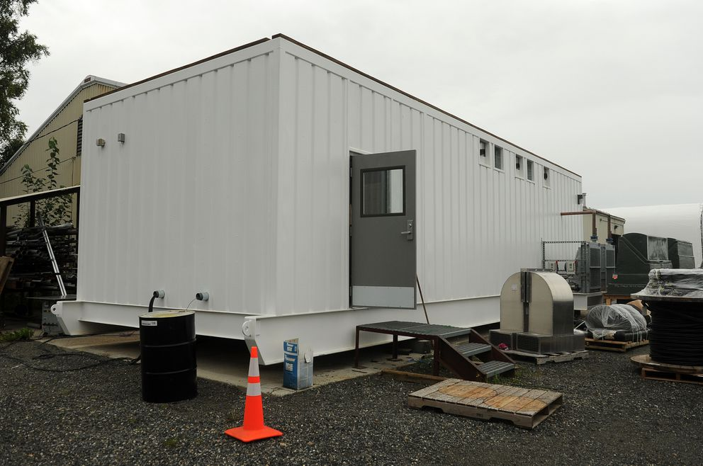 The powerhouse module that is being built by the Alaska Energy Authority sits in a yard off of Commercial Drive in Anchorage, AK on Thursday, August 11, 2016. The power module, that is destined for Perryville, AK, will integrate the existing wind farm, which does not work well with the current generator. (Bob Hallinen / Alaska Dispatch News)
