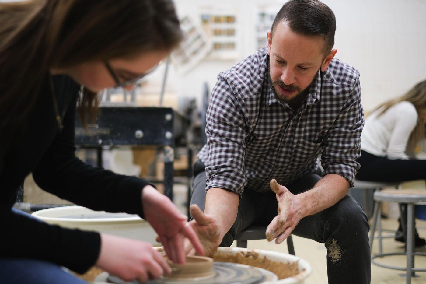 Jacob Bera teaches ceramics in his visual arts class at Eagle River High School. (NEA-Alaska / Levi Brown)